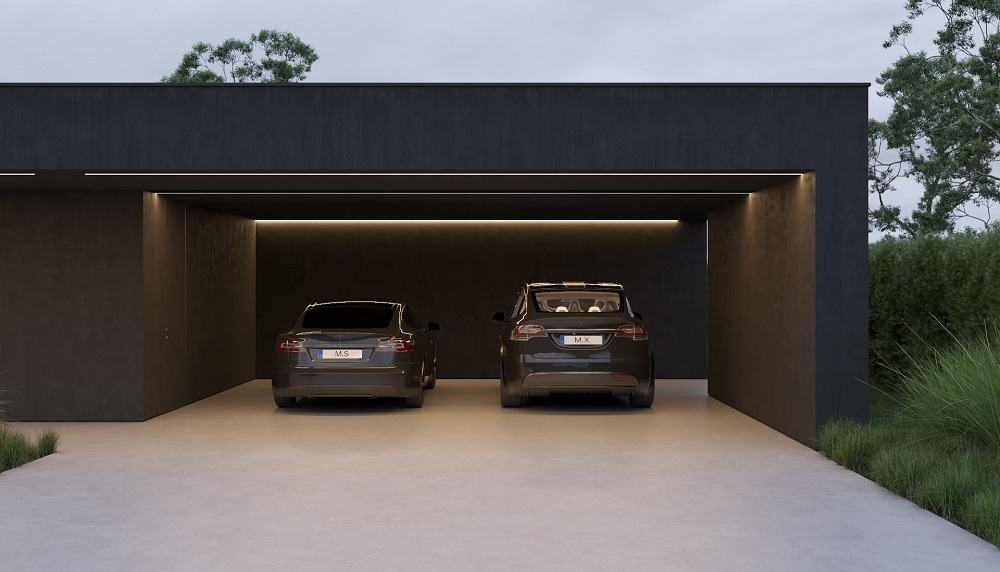 At the far right side of the front of the house is the car port and driveway that can fit two cars underneath its ceiling.