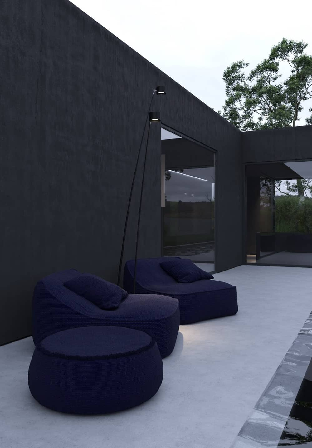 The poolside area is adorned by the large cushioned outdoor dark lounge chairs and a matching cushioned coffee table.
