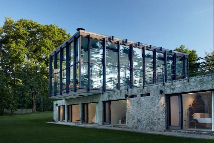 This is a close look at the back of the house that shines from its glass structures and walls that are supported by dark beams. Images courtesy of Toptenrealestatedeals.com.