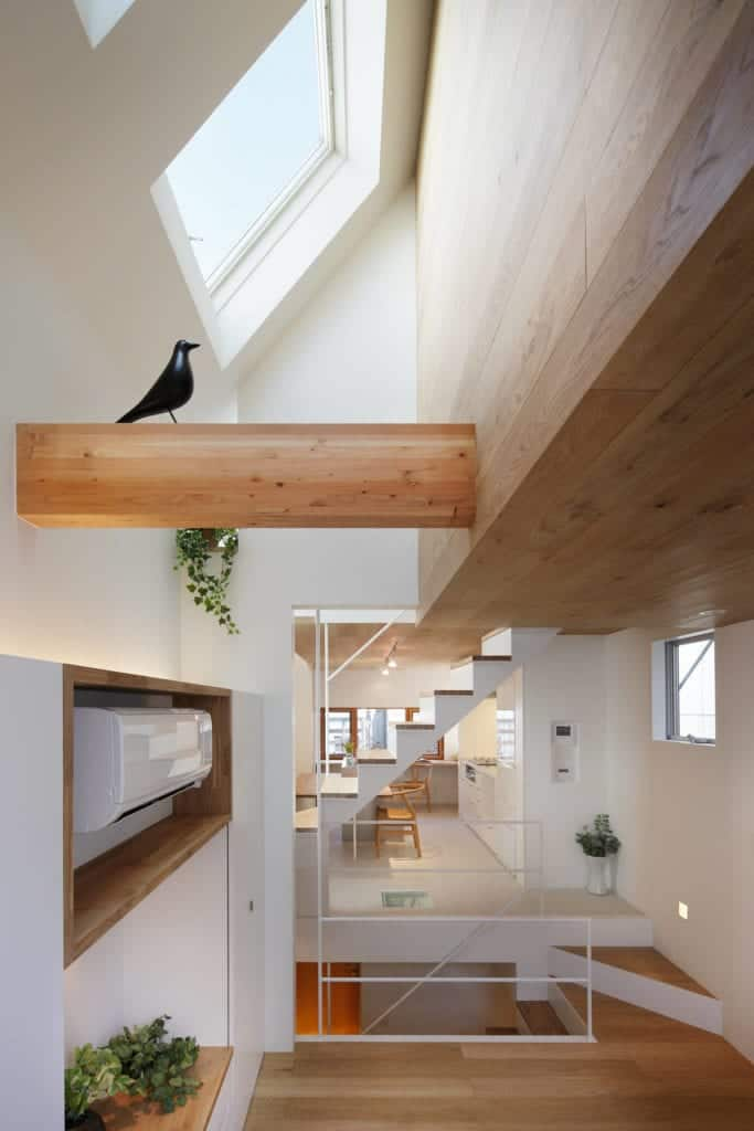 This is a closer look at the wooden beam of the wooden shed ceiling adorned with a decorative bird figurine.