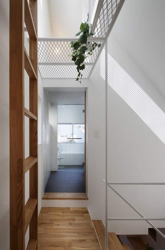 This is a look at the hallway from the vantage of the bedroom door. You can see more of the wooden ladder on the side.