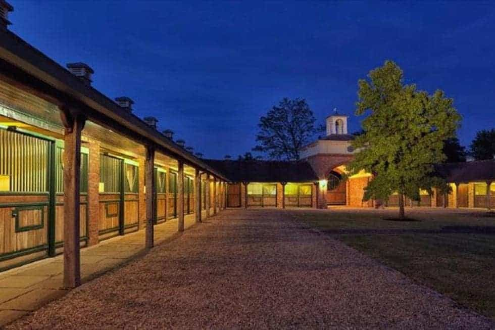 This is a close look at the equestrian center of the property with several stables and stalls surrounding a large courtyard. Image courtesy of Toptenrealestatedeals.com.