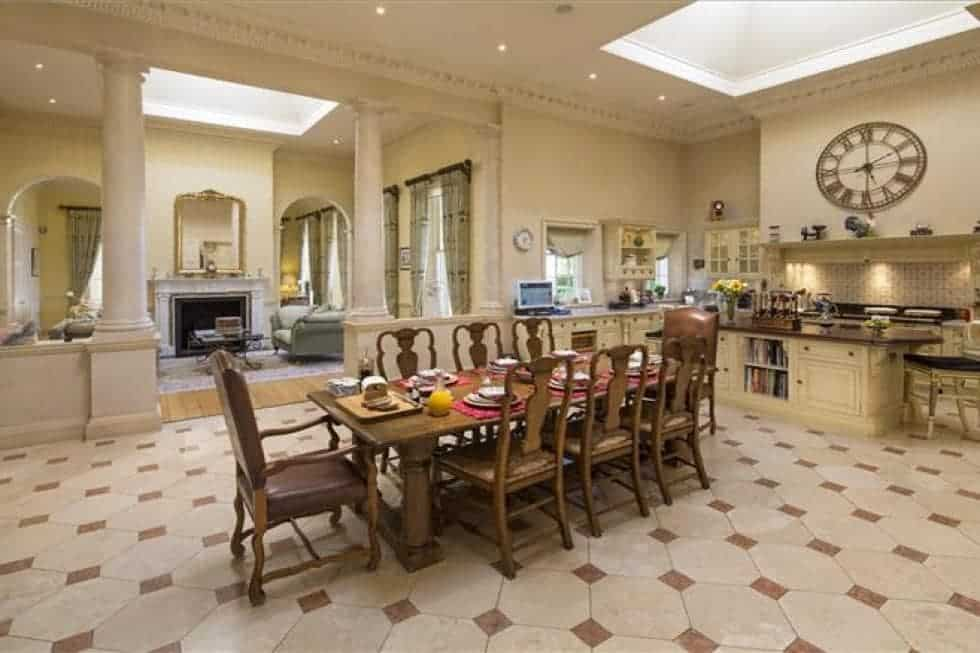 This is the spacious kitchen with beige walls and ceiling to match the cabinetry lining the walls. There is enough space for a large wooden dining table for the breakfast area. Image courtesy of Toptenrealestatedeals.com.