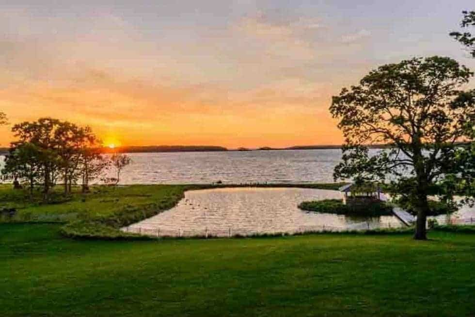 This is the water scenery afforded by the landscape of the property. This complements the wide grass lawns and tall trees of the backyard. Image courtesy of Toptenrealestatedeals.com.