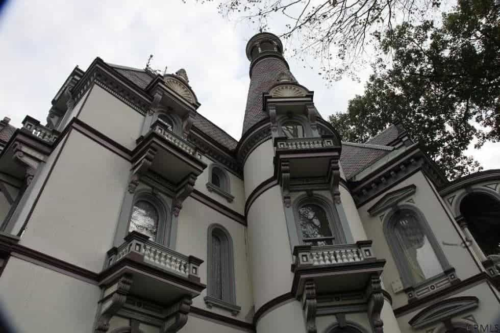 This is a closer look at the exterior walls of the house with its many intricate details and small balconies. Image courtesy of Toptenrealestatedeals.com.