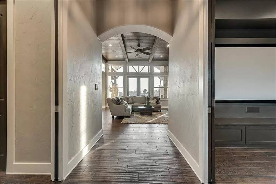 View of the living room through the arched way of the foyer.