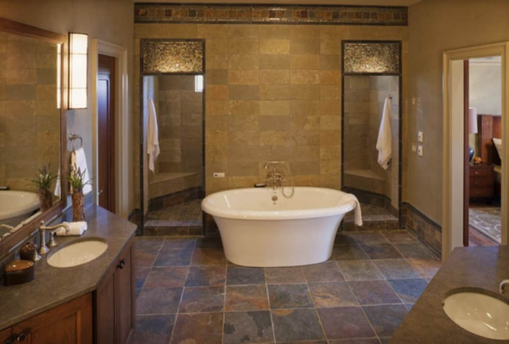 Primary bathroom with two wooden vanities, a toilet room, a freestanding tub, and a spacious walk-in shower.Primary bathroom with two wooden vanities, a toilet room, a freestanding tub, and a spacious walk-in shower.