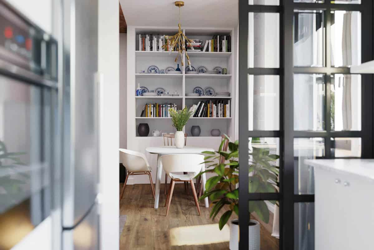 The white shelves are filled with decors and books to set a background for the dining area with a white dining table surrounded by white modern chairs.