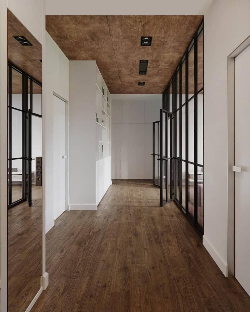 Upon entry of the small apartment, you are welcomed by this simple foyer hallway with a hardwood flooring that matches the ceiling.