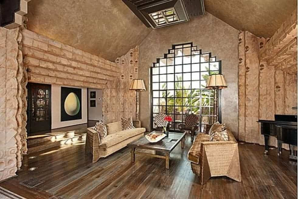 This is the living room that has a large glass wall on the far side to bring in natural lighting for the beige chairs that stand out against the hardwood flooring but matches the walls. Image courtesy of Toptenrealestatedeals.com.