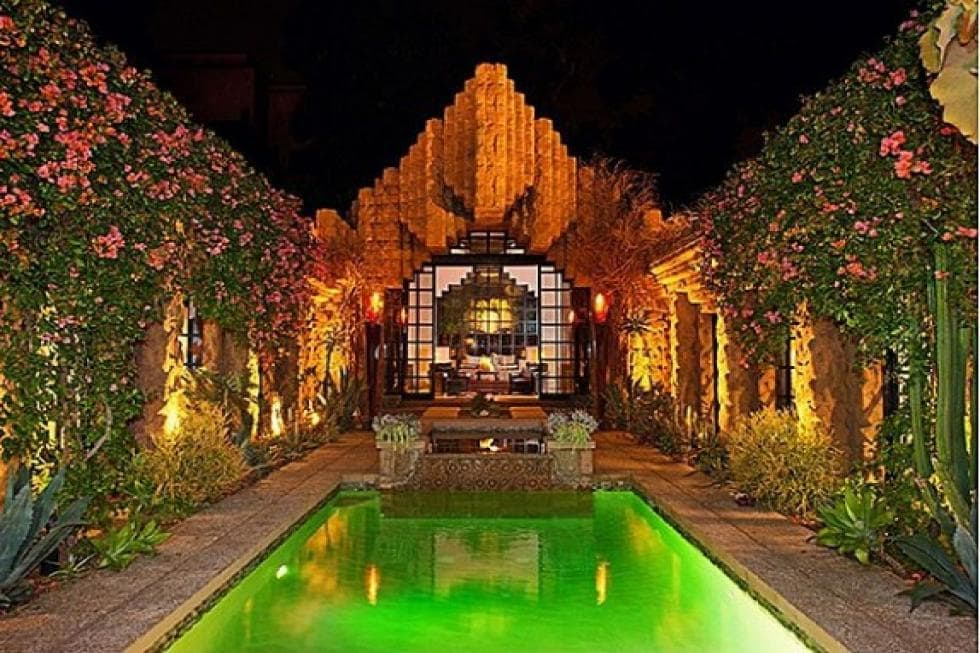 This is the pool that has its own lighting to contrast the warm light of the house exterior adorned with creeping plants. Image courtesy of Toptenrealestatedeals.com.