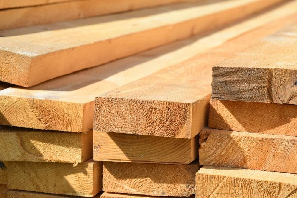 Closeup of stacked lumber.