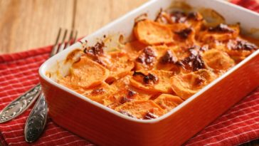 A serving of freshly-baked sweet potato casserole.