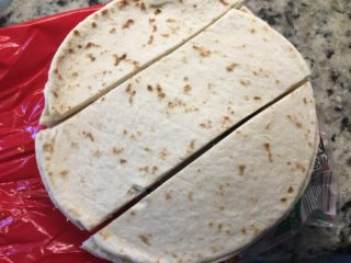 The tortillas are sliced into even strips.