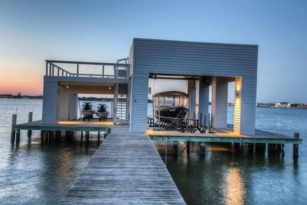 This is the boathouse at the end of the wooden walkway that can fit a boat and a couple of jet skis. Image courtesy of Toptenrealestatedeals.com.