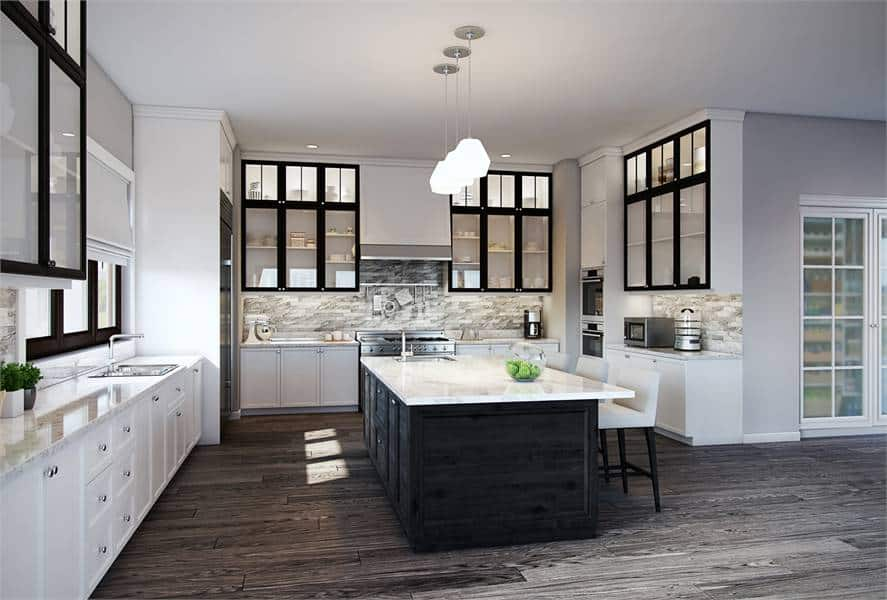Kitchen with white cabinetry, marble countertops, stainless steel appliances, and a large breakfast island.