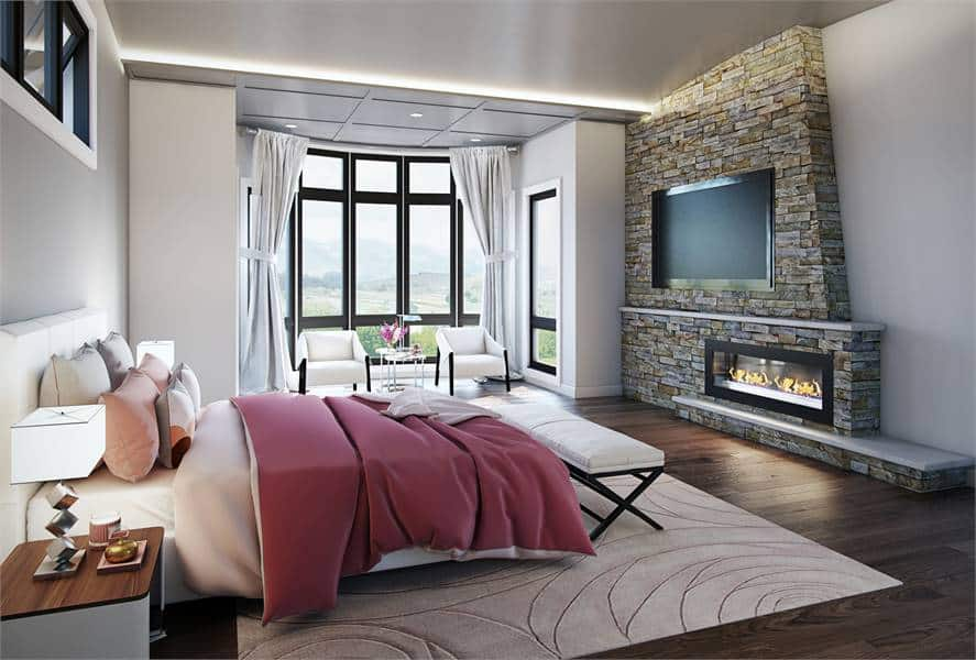 The primary bedroom has a white upholstered bed, a bayed sitting area, and a stone fireplace with a TV on top.