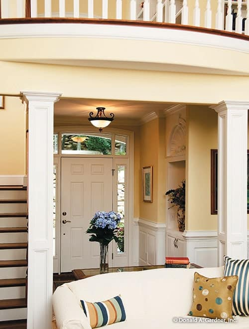 Foyer with a white entry door, glass dome pendant, and a display niche.