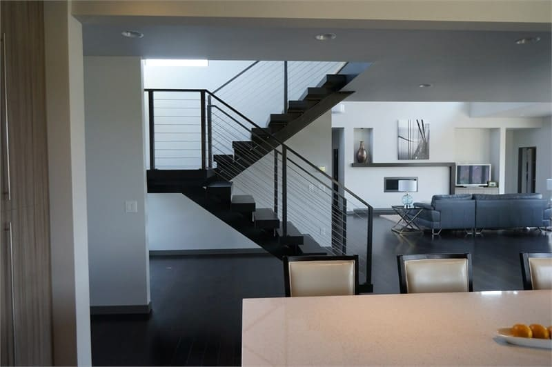 Side view of the staircase situated in between the living room and kitchen.