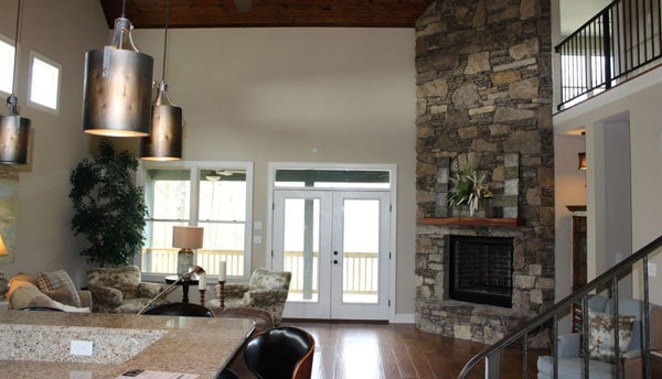 The white french door on the far end opens to the back porch.