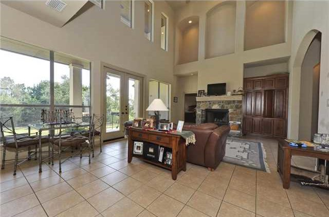 The breakfast nook behind the living area offers a metal dining table and cushioned chairs.