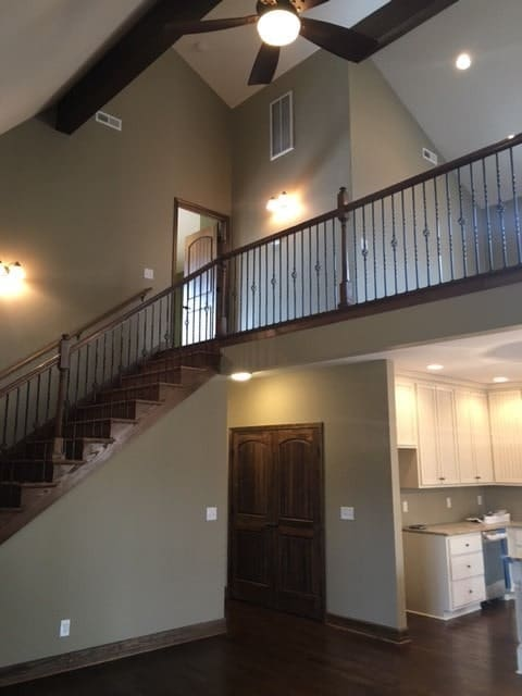 The wooden staircase on the side takes you to the balcony loft.