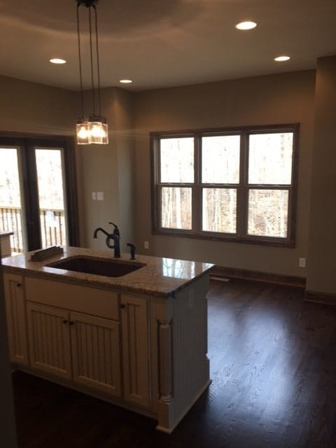 The spare space across the kitchen island is dedicated to the dining area.