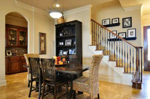 The dining room offers a black shelving unit, a rectangular dining set, and a glass dome pendant.