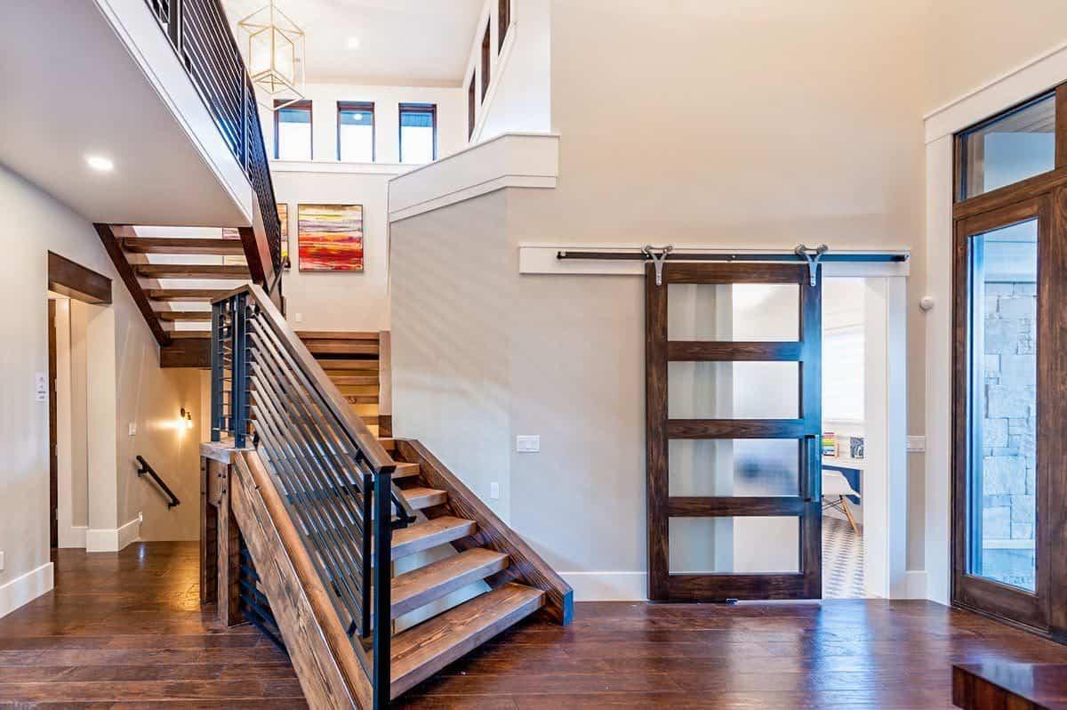 The glass barn door opens to the flexible study/den.