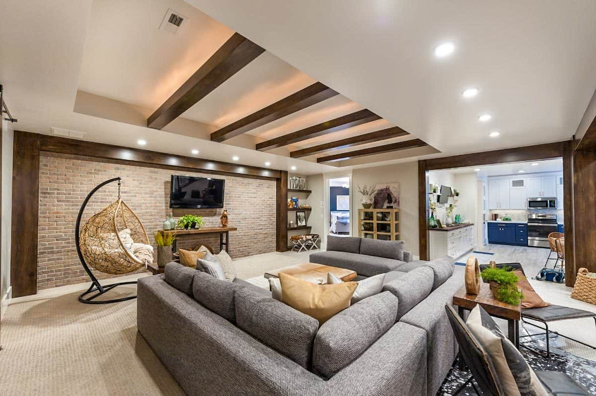 An open layout view showing the living room, kitchen, and breakfast nook.