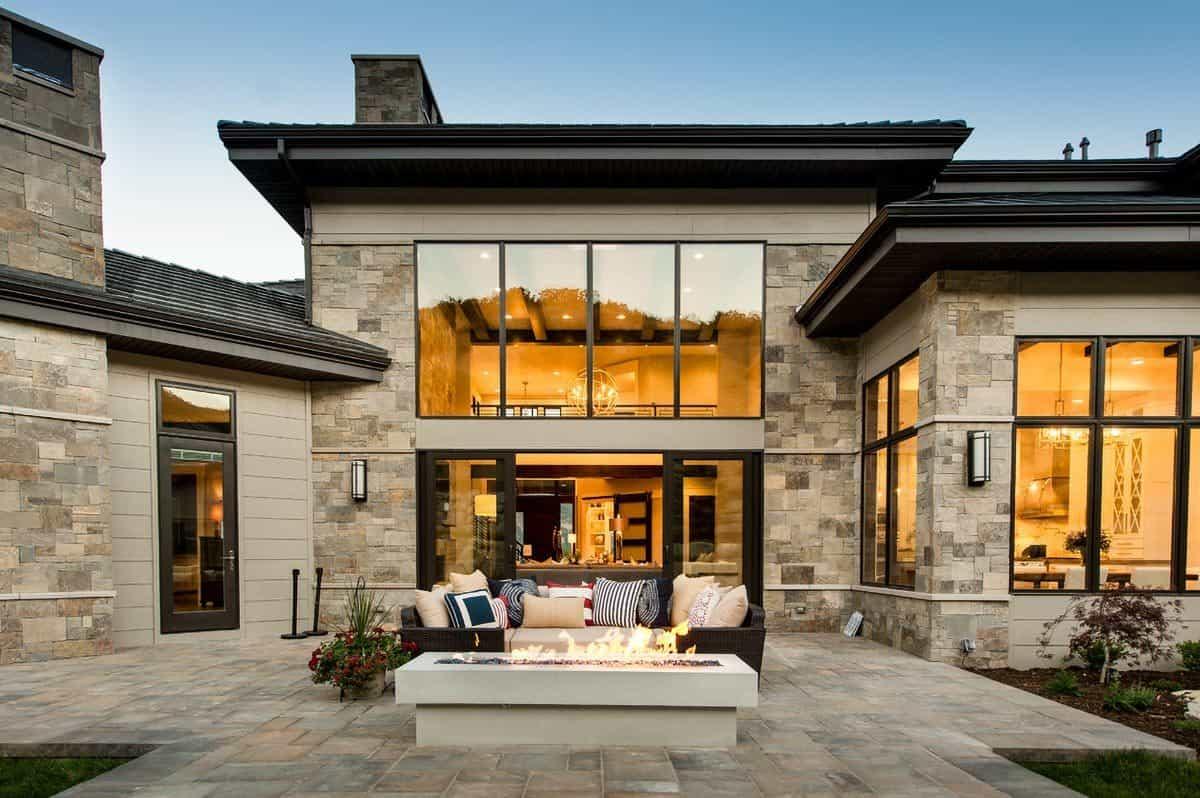 Stone exterior walls match the patio's limestone flooring.