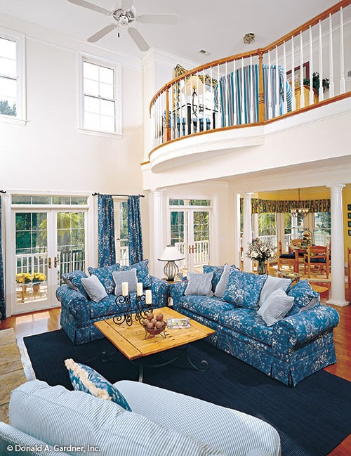 Family room with a two-story ceiling, clerestory windows, and a loft balcony.