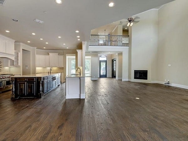 Kitchen with white cabinets, stainless steel appliances, two islands, and recessed ceiling lights.