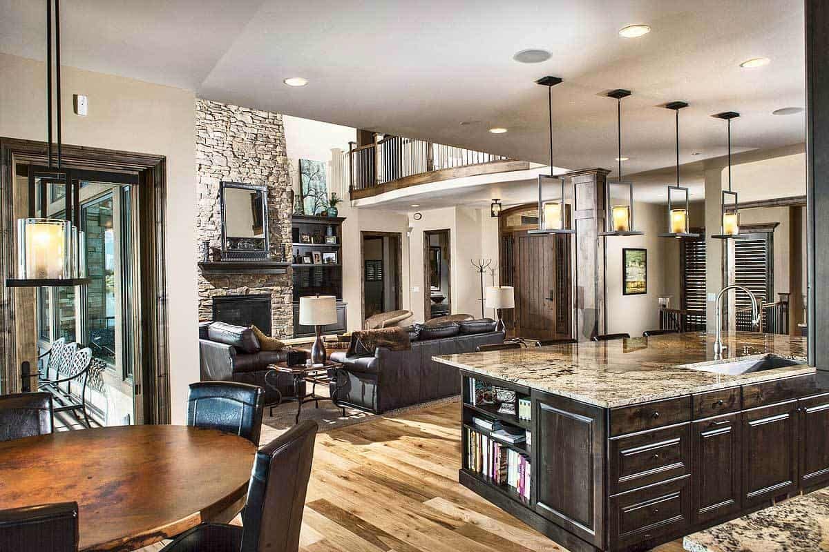 An open layout view showing the living room, kitchen, and casual dining area.