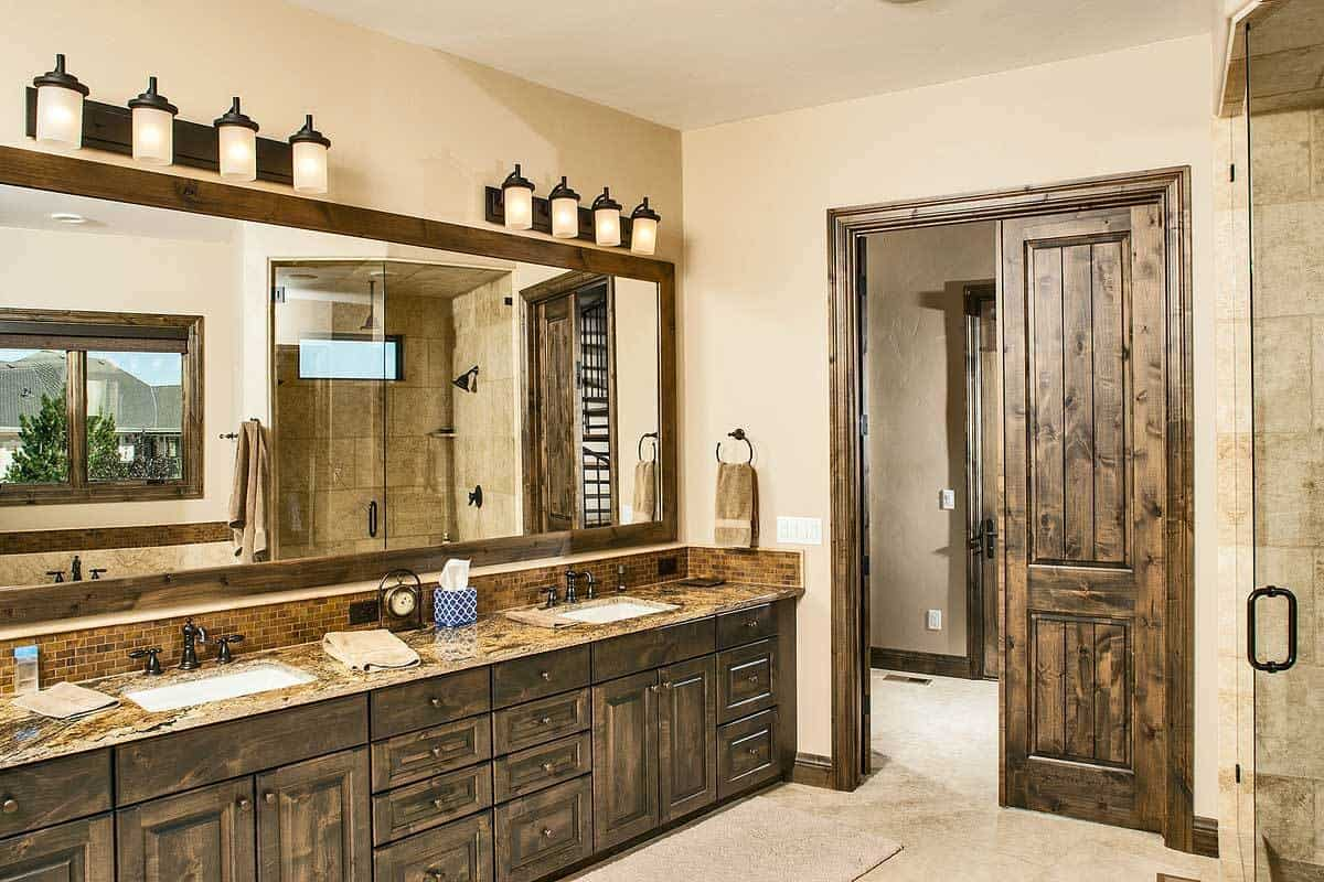 The primary bathroom features a dual sink vanity paired with a long rectangular mirror.