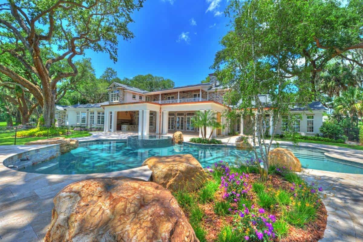 A sparkling pool with a built-in spa complements the covered lanai.