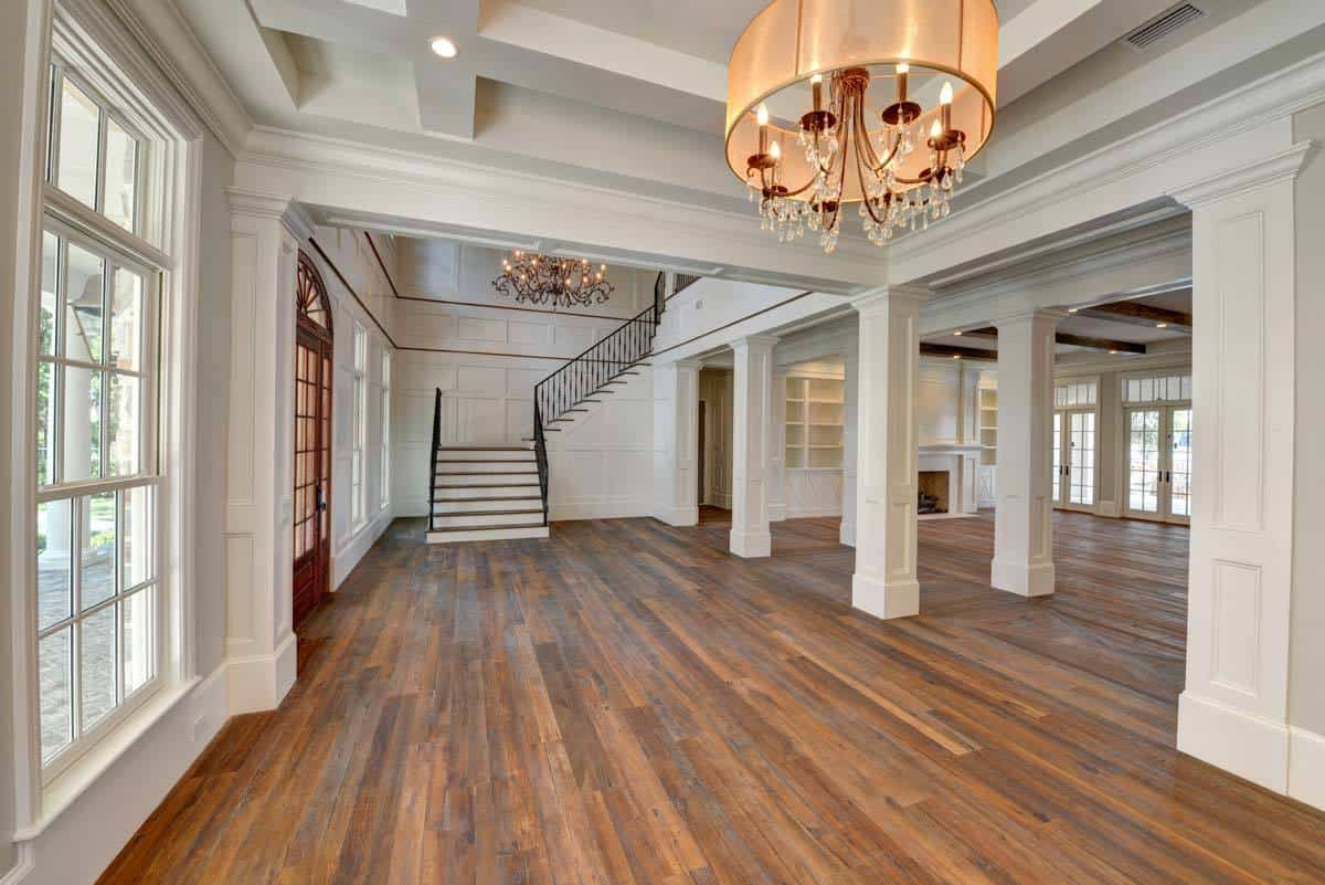 This spare space with a coffered ceiling and a drum chandelier is dedicated to the formal dining room.
