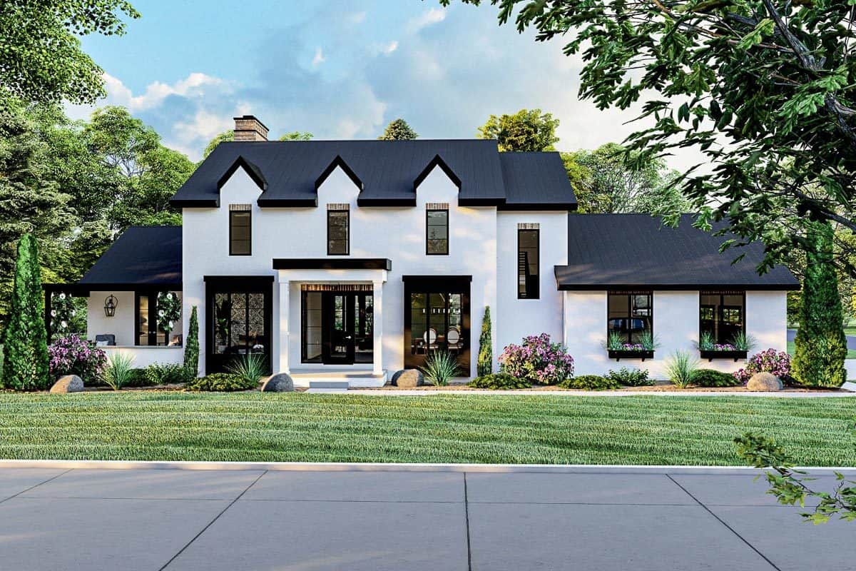 Front exterior view with white stucco siding, triple dormers, and a sleek covered porch.
