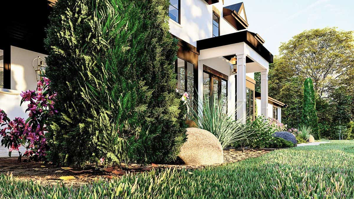 An angled side view showing a variety of plants complementing the house.