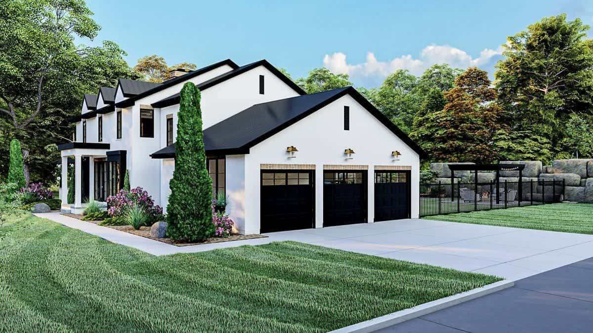 Right side view showing the three-bay garage and concrete driveway.