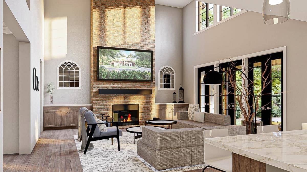 Living room with gray seats, round modular tables, and a stone fireplace with a TV on top.