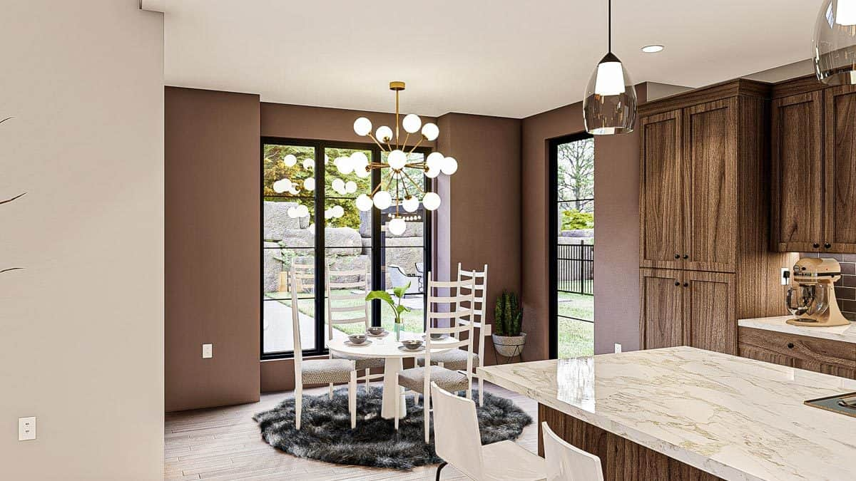 Breakfast nook with cushioned chairs, round dining table, and a sputnik chandelier.