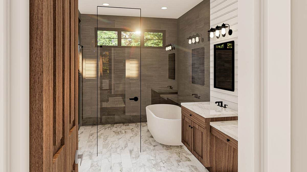 The primary bathroom has a marble top vanity, a freestanding tub, and a walk-in shower.