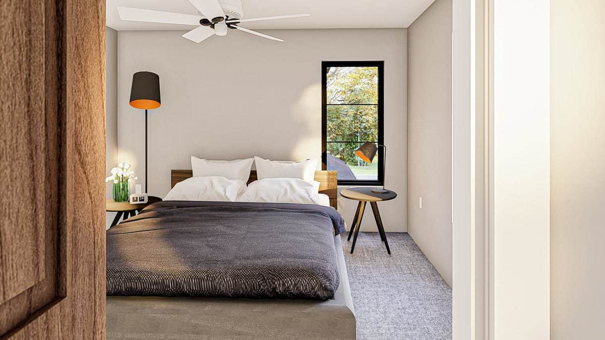 Another bedroom with a platform bed, round nightstands, a drum floor lamp, and carpet flooring.