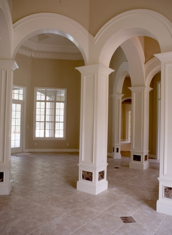 Home interior showcasing the decorative archways and marble tiled flooring.