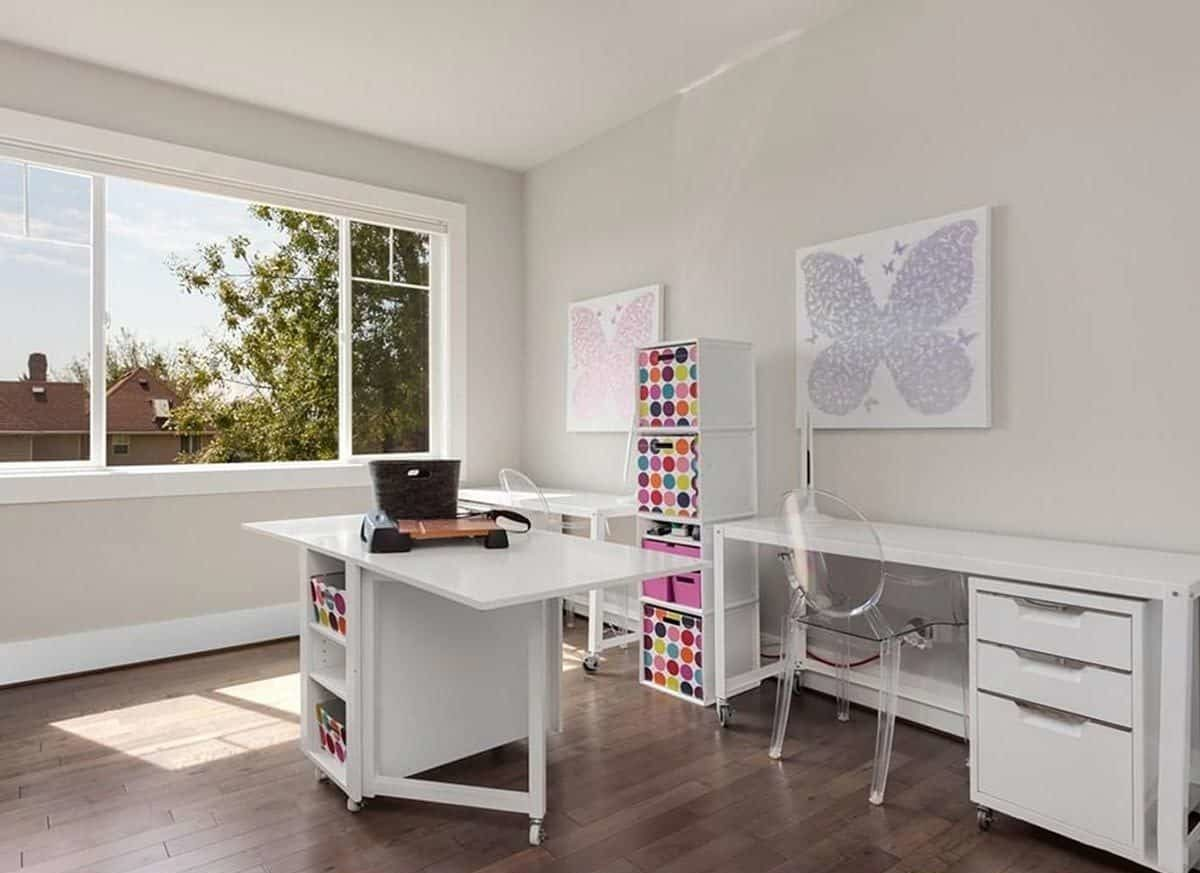 The craft room is filled with white tables, glass chairs, butterfly artworks, and colorful storage boxes.
