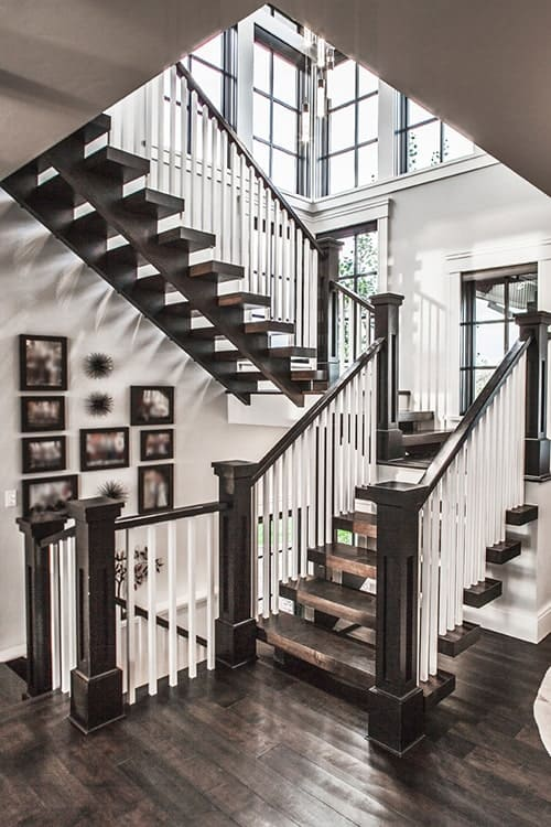 Dark wood staircase leading to the basement and sleeping quarters upstairs.