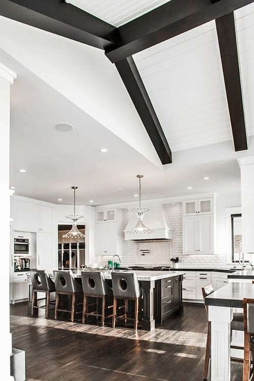 A farther view shows the breakfast nook in front with a wooden dining set.