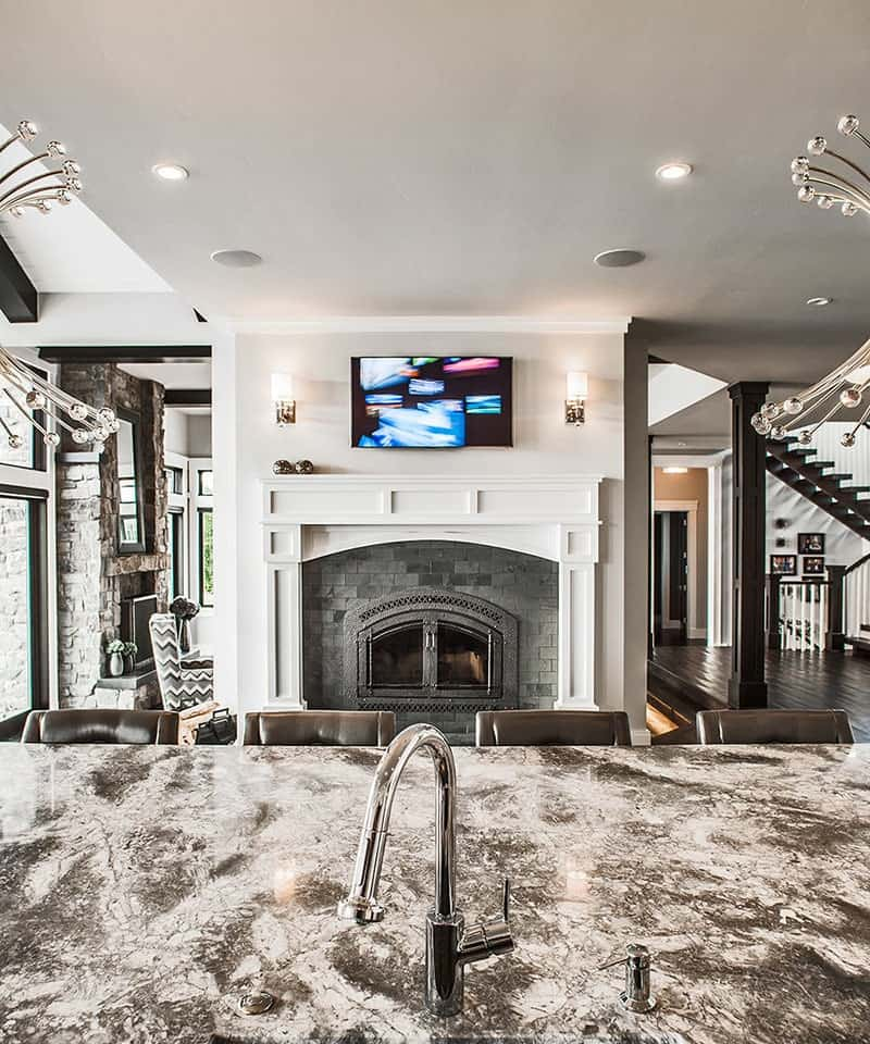 A fireplace situated behind the living room warms the kitchen.