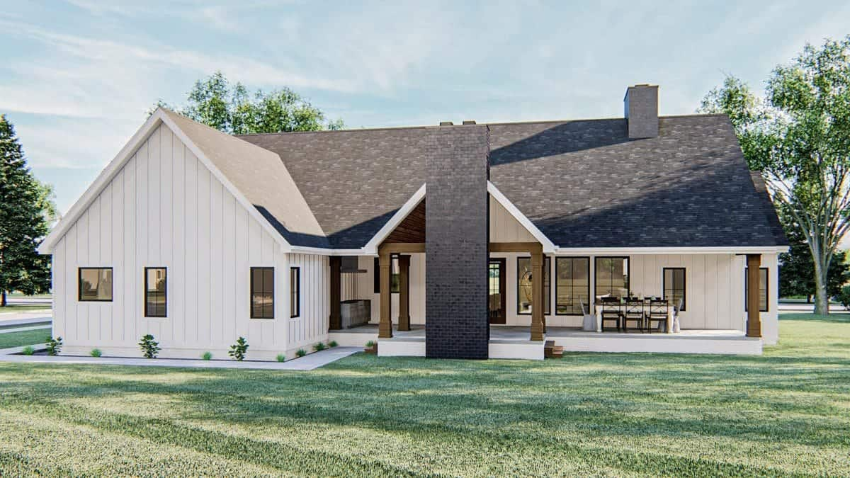 Rear exterior view with a covered patio warmed by a stone fireplace.